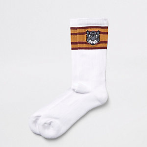 Witte sokken met geborduurde beer