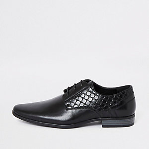 Black 'RI' embossed derby shoes