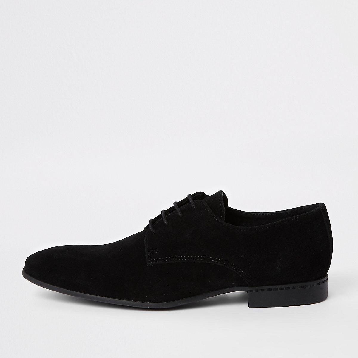 Chaussures derby lacées en daim noires