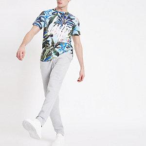 Hype – T-shirt à imprimé tropical bleu avec ourlet arrondi