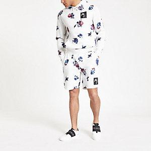 Weiße, geblümte Slim Fit Jersey-Shorts