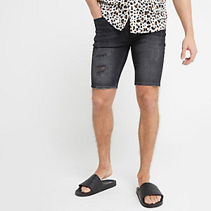 Black Ollie spray on denim shorts