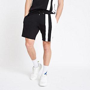 Zwarte slim-fit short met kleurvlakken