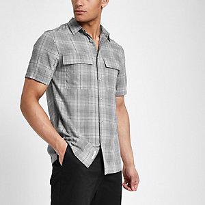 Chemise grise à manches courtes et carreaux