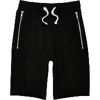 Boys black drop crotch shorts