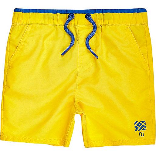 Mini boys yellow swim shorts