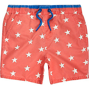 Mini boys orange star print swim trunks