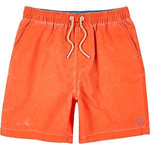 Boys bright orange swim trunks