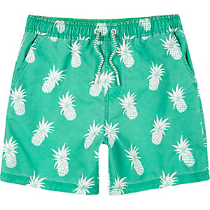 Boys bright green pineapple print swim trunks