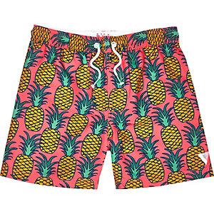 Boys pink pineapple print swim trunks