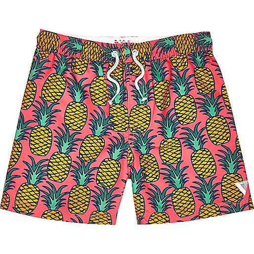 Boys pink pineapple print swim shorts