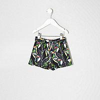 Mini boys black toucan print swim trunks