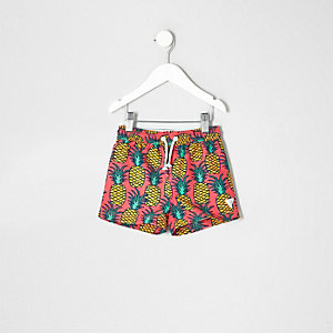 Mini boys pink pineapple print swim trunks