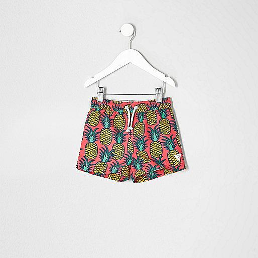Mini boys pink pineapple print swim trunks