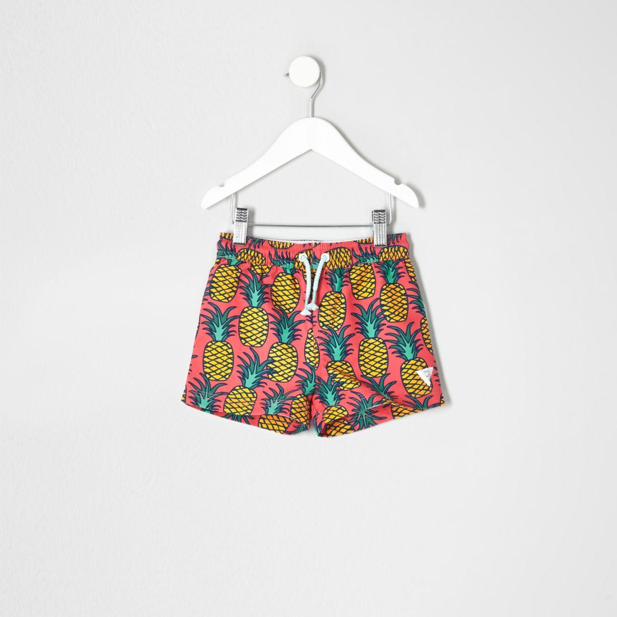 Mini boys pink pineapple print swim shorts