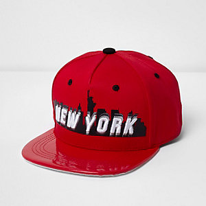 Boys red New York shiny peak cap
