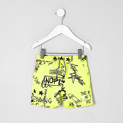 Mini boys yellow graffiti print swim trunks