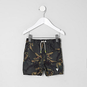 Mini boys khaki green dino print swim trunks