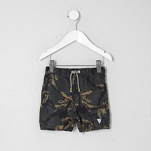 Mini boys khaki green dino print swim trunks