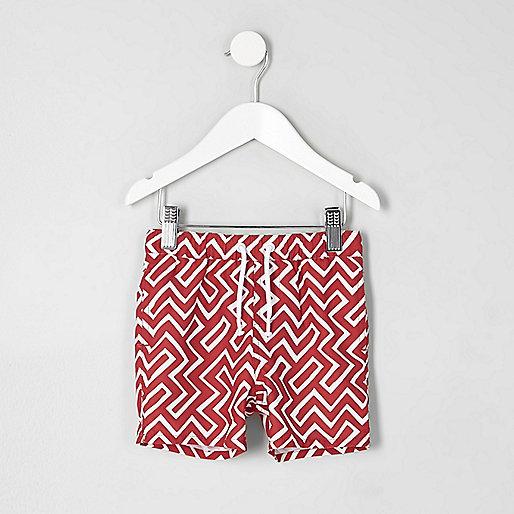 Mini boys red geo print swim trunks