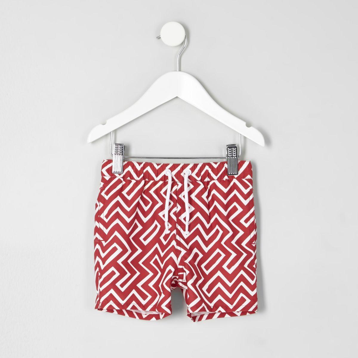 Mini boys red geo print swim shorts