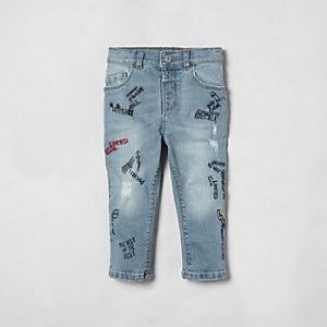 Mini - Sid - Middenblauwe skinny jeans met tekeningetjes voor jongens