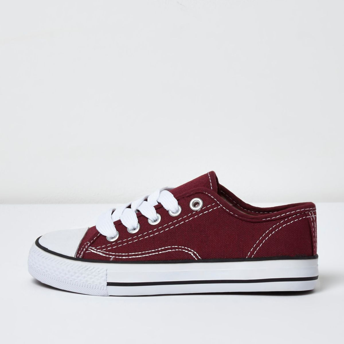 Boys red low top lace-up plimsolls