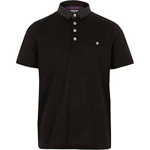 Schwarzes Poloshirt mit Punkten