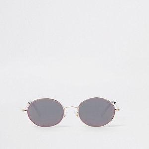 Silberne, ovale Sonnenbrille mit grauen Gläsern