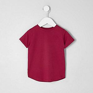 T-Shirt in Dunkelpink mit abgerundetem Saum