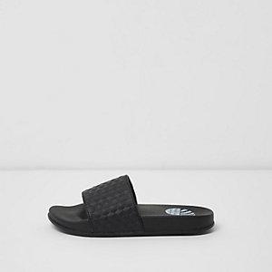 Schwarze, strukturierte Slipper