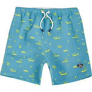 Boys blue shark print swim shorts