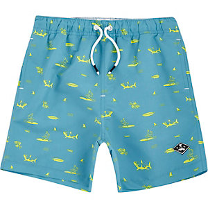 Boys blue shark print swim trunks