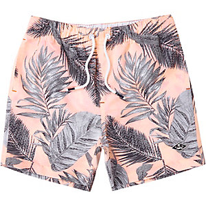 Boys pink floral print swim trunks