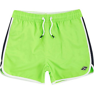Boys bright green runner swim trunks