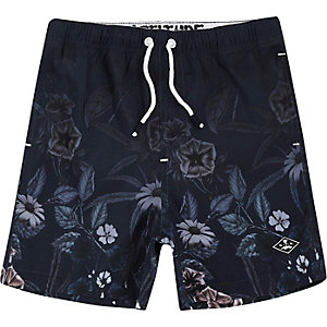 Boys navy floral fade print swim trunks
