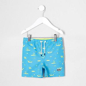Mini boys blue shark print swim shorts