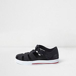 Sandales en plastique effet cage noires mini garçon