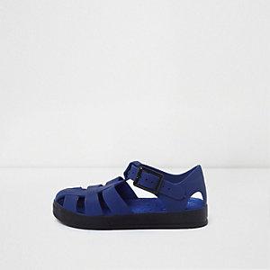 Sandales effet cage en plastique bleu mini garçon
