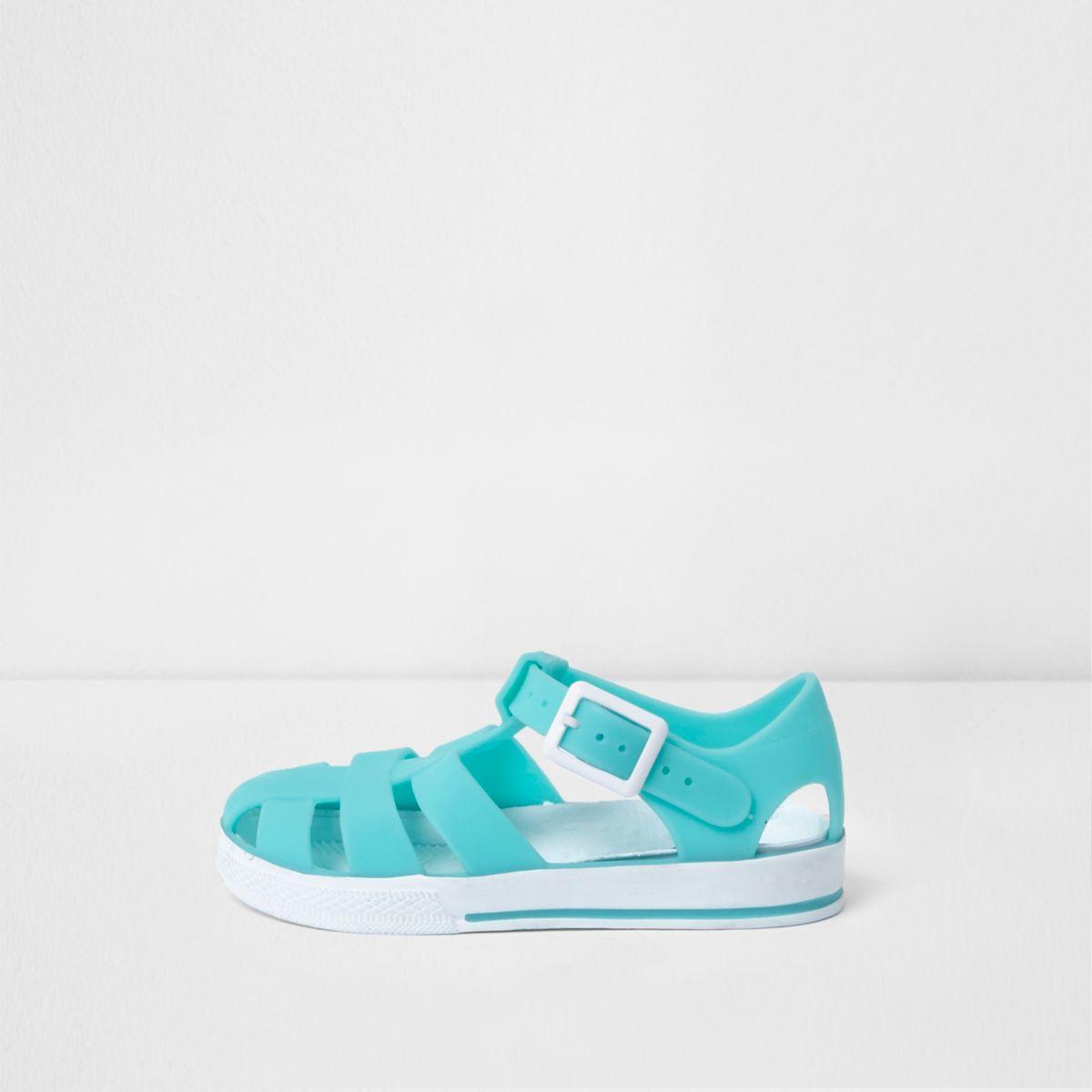 Sandales en plastique bleu vif effet cage mini enfant