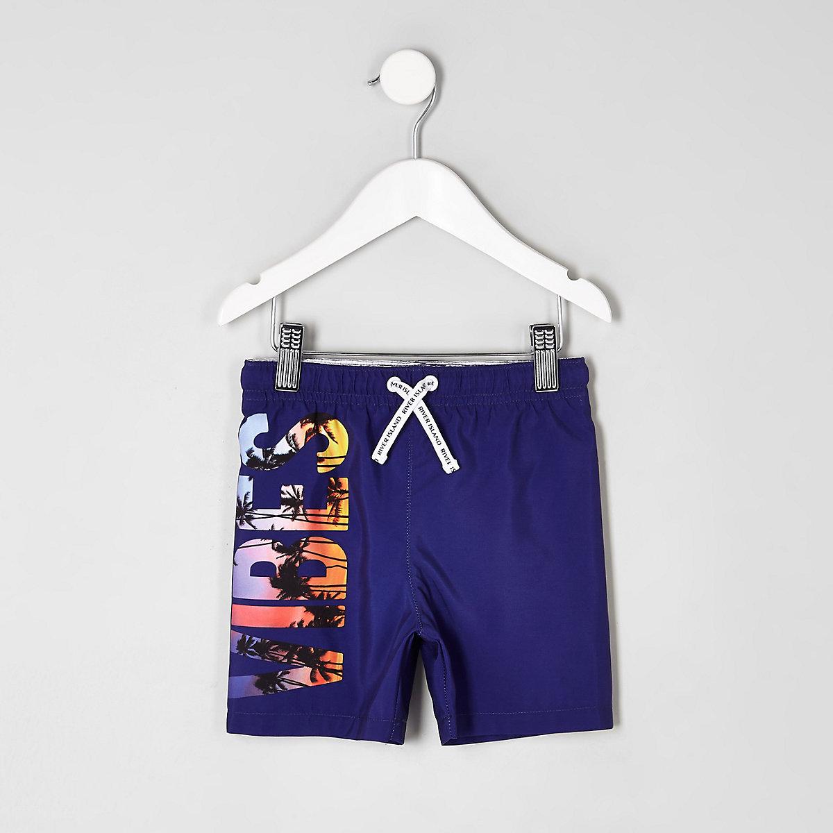 Mini boys purple 'vibes' print swim shorts