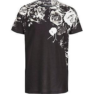 Schwarzes T-Shirt mit verblasstem Blumen-Motiv