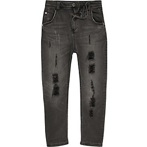 Boys black Tony ripped tapered slouch jeans
