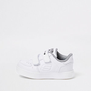 Mini boys Skechers white light-up trainers