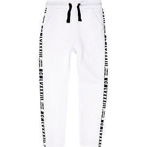 Witte joggingbroek met 'limited edition'-print voor jongens