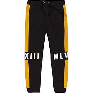 Pantalon de jogging noir avec empiècements contrastants pour garçon