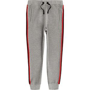 Pantalon de jogging côtelé gris à bandes pour garçon