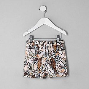 Mini boys pink tiger print swim trunks