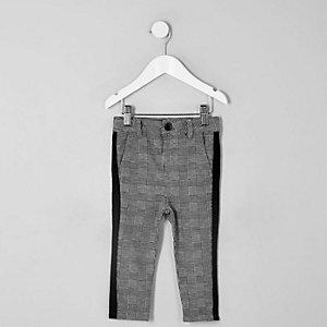 Pantalon gris à carreaux et bandes mini garçon