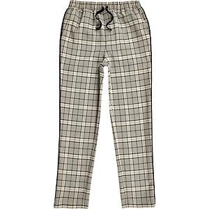 Pantalon fuselé à carreaux écru pour garçon